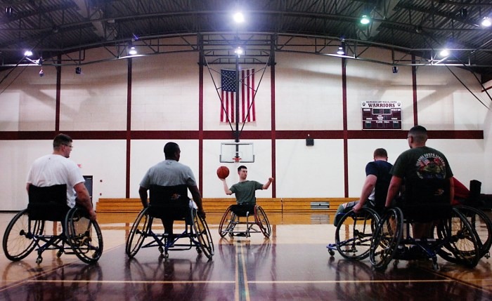 USMC Cpl. Raymond Hennagir looks to pass the ball, during a wounded warriors practice inside the Karen Wagner Sports Center at the Walter Reed Army Medical Center to prepare for the Warrior Games.  For The News & Messenger